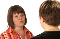 Two women are practicing interview questions together