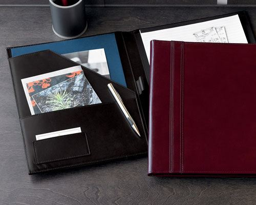Nice work portfolio in red leather skin, and another one in a black leather cover