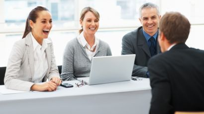 A job candidate made his interviewers to laugh. Illustration of some unorthodox ways of interviewing for the job. We can see three interviewers on the picture, two women and one man, all of them are laughing.