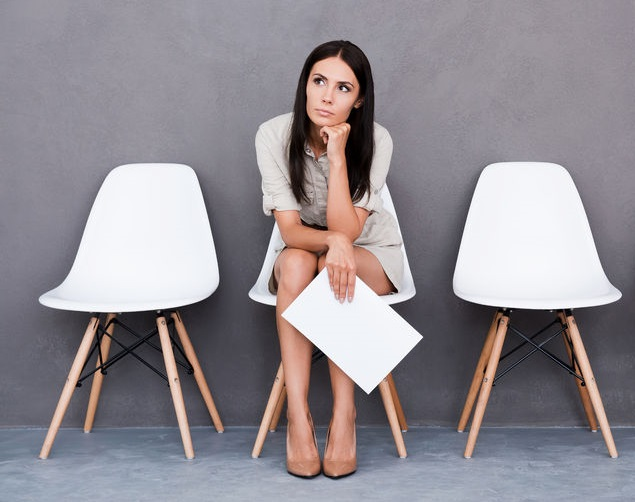 job applicant waiting for her chance. Holding their resume tight in hands, repeating the answers to the most common questions
