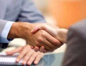 handshake of two businessmen illustrates the agreement at the end of a job interview