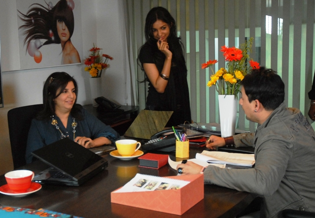 People in easy going informational interview, the man is trying to understand the possibilities to get the job with them. Two female interviewers are relaxed, smiling