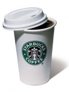 A typical take-away cup with starbucks logo. White color, green logo