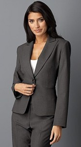Woman wearing conservative interview attire, pants, jacket, and white blouse.