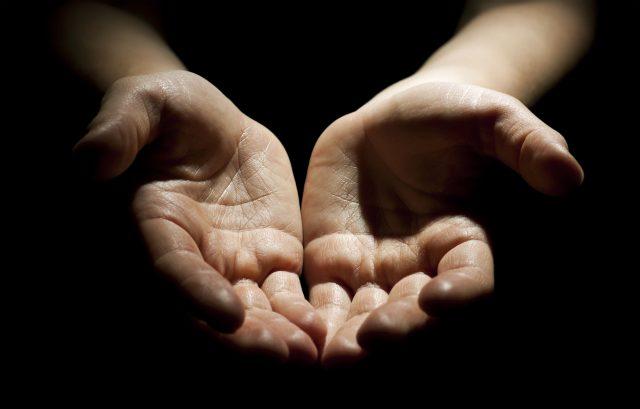 Open palms symbolize an offer of help. Illustration of a goal of job coaching.