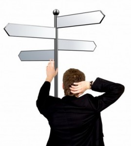 Man is standing on a crossroad of his career, illustration, a man standing below a signpost that shows many directions.