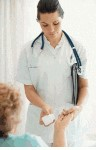 Physician assistant treats a patient