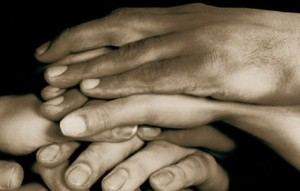 Many hands placed on each other, as a symbol of social work and diversity we have in the world. A black and white picture.