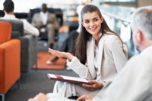nice woman holds her work portfolio, as she tries to make a good impression on the recruiting manager
