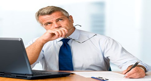 the CEO is thinking. We can see him holding his glasses in hand, lost in thought, while he tries to formulate his thoughts on a piece of paper.