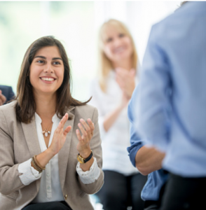 people are smiling and aplauding at the end of a job interview