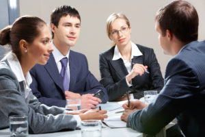 A group interview for a project manager position. Two women and one man try to make an impression on the HR manager.