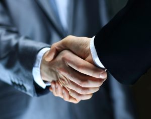 People shake hands at the end of a job interview.