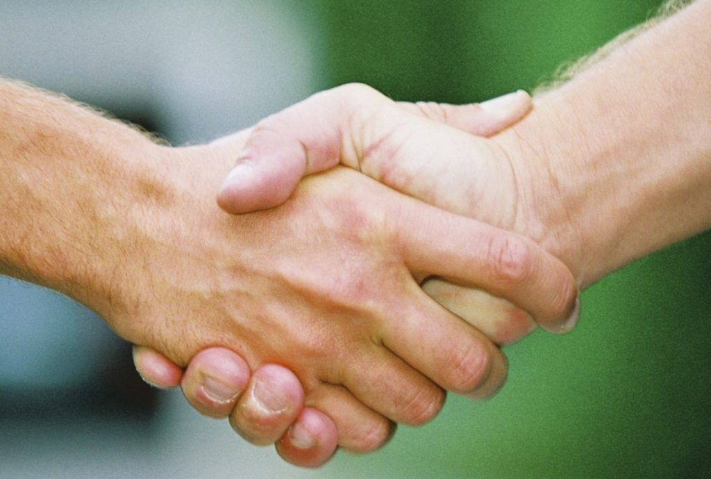 Friendly handshake at the end of a job interview.