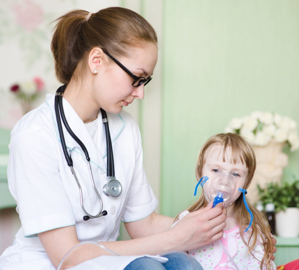 Respiratory Therapist in work, taking care of a child.