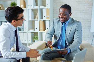 Job interview in an office of an HR manager. We can see both them and the job candidate.