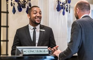 Concierge helps the guest with the smile on their face