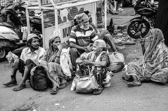 people in India, suffering material poverty