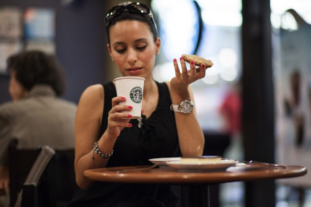 Woman drinking coffee at her favorite retailer