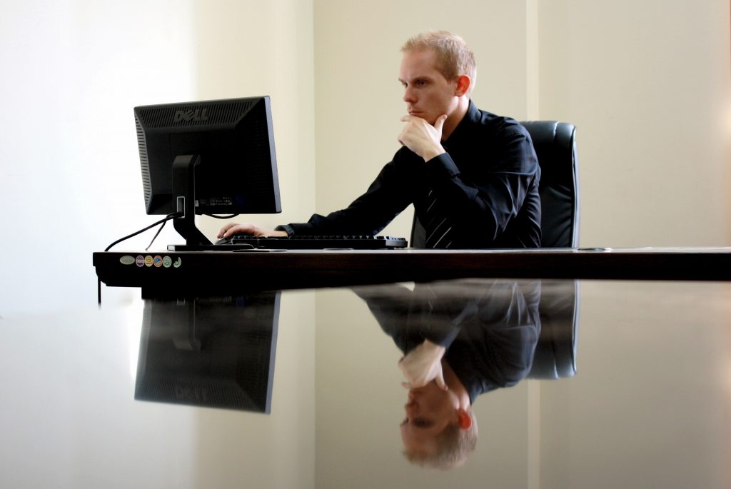 Man is working on a computerized test in his interview