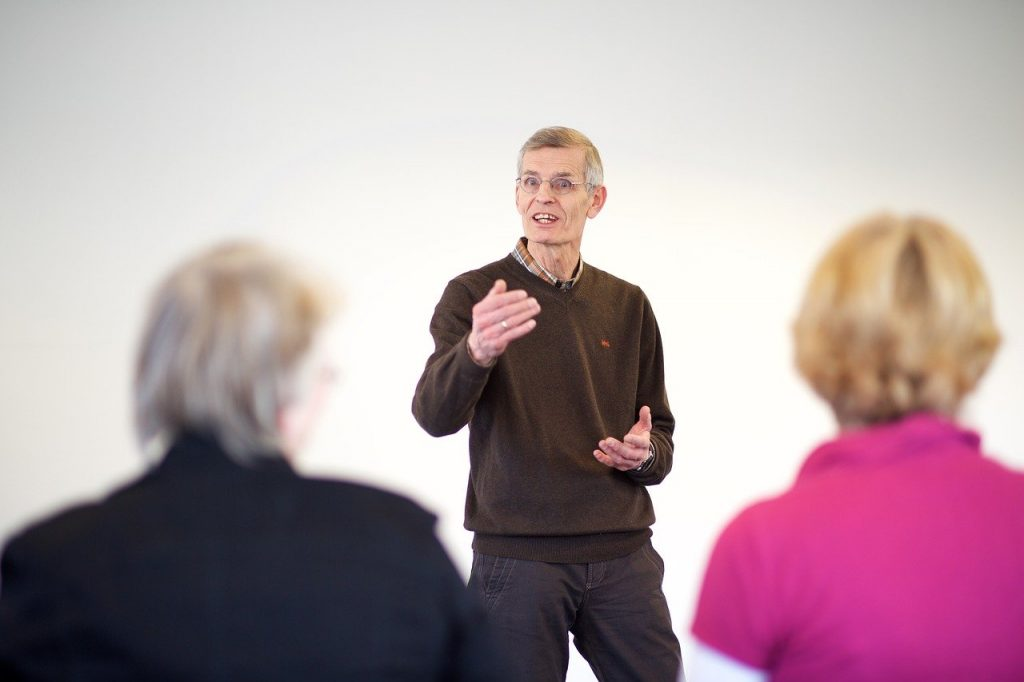 litaracy coach instructs two female teachers