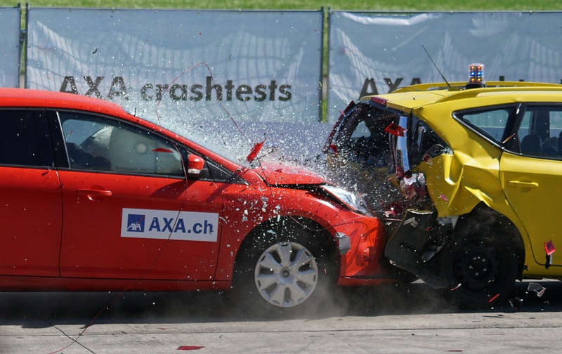 picture from a crash test in an insurance company, red and yellow car