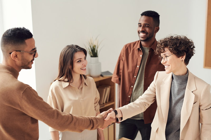 people shake hands at the end of a successful job interview