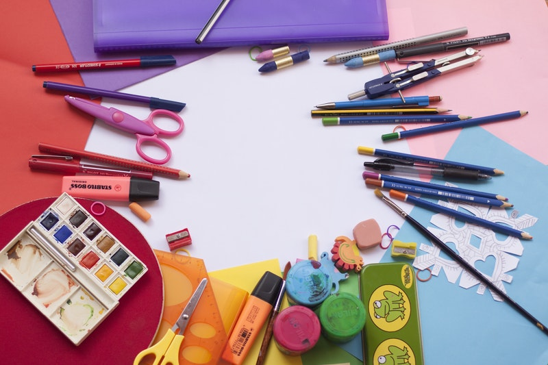 nice colorful set of painting and drawing tools on the table