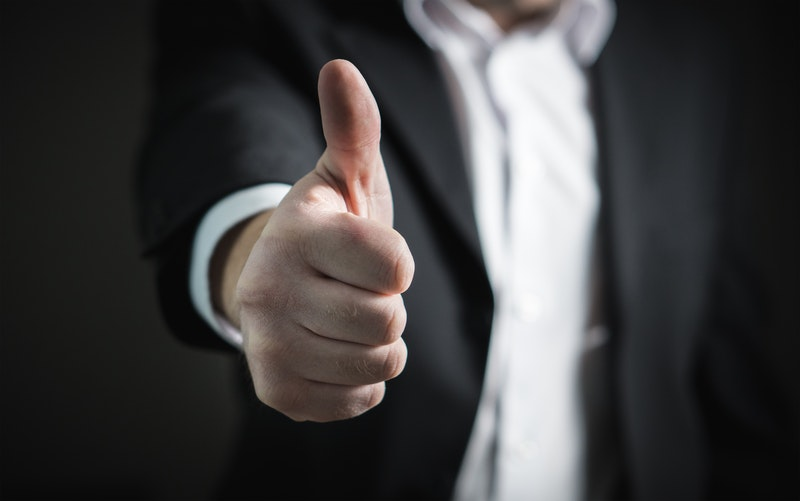 businessman with thumb's up, an an illustration of a satisfied customer