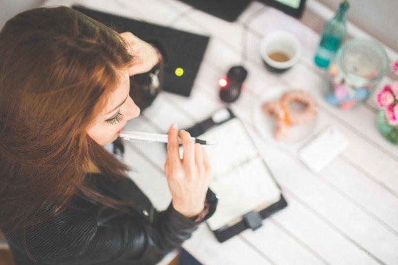 woman in black works hard to meet a deadline
