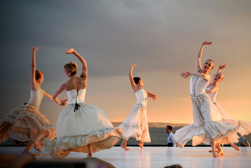 five professional female dancers in beautiful white dresses